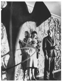 Peggy Guggenheim and Jackson Pollock in front of the Mural, 1943. Photo: © courtesy George Kargar