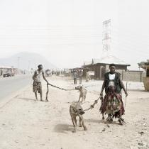 Pieter Hugo, Mallam Galadima Ahmadu with Jamis and Mallam Mantari Lamal with Mainasara, Nigeria, 2005. From the series Hyena and Other Men. � Pieter Hugo, Courtesy Yossi Milo Gallery, New York and Stevenson Gallery, Cape Town
