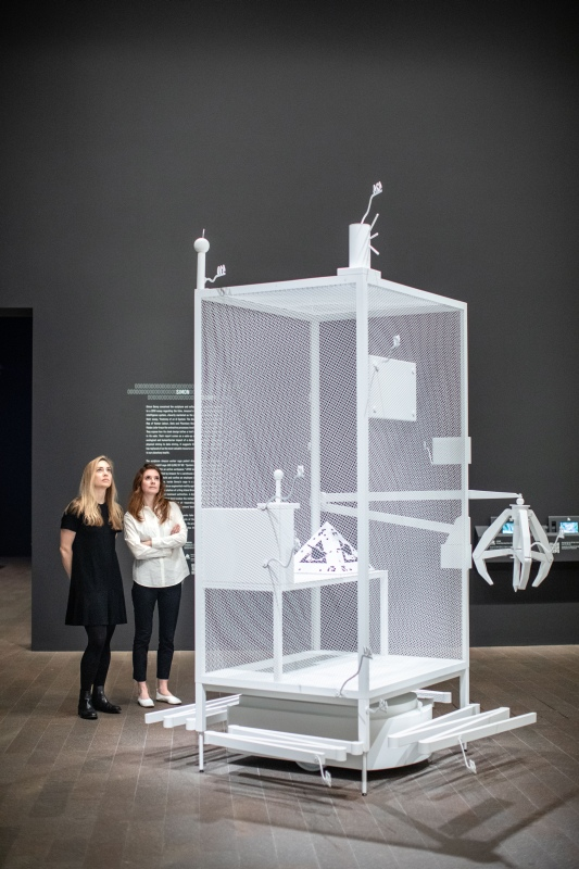 "Simon Denny, Amazon worker cage patent drawing as virtual King Island Brown Thornbill cage (US 9,280,157 B2: ""System for transporting personnel within an active workspace"", 2016), installation view, de Young museum, 2020. Photo: Gary Sexton"